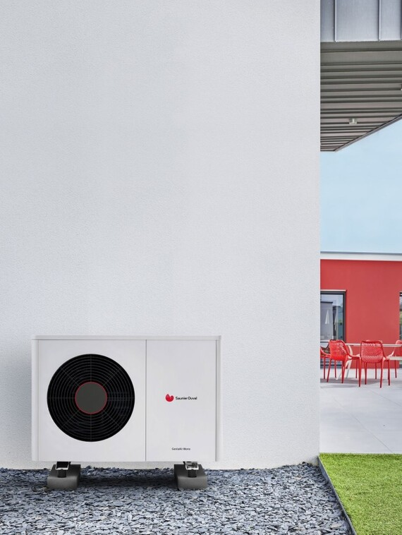 Air-to-water heat pump GeniaAir Mono infront of a housewall of a new build